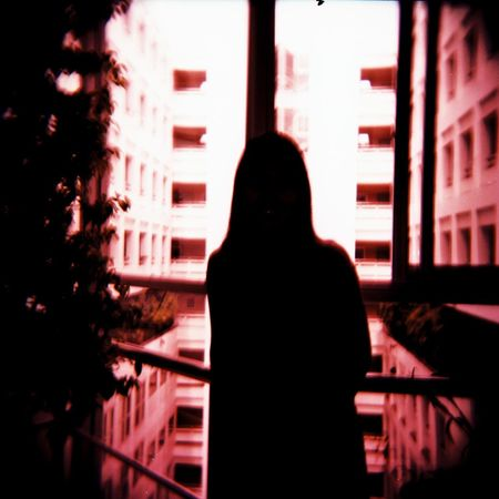Friendscape : Holga Cam with forgotten film type. 05 Holga Holga Photography Red Architecture Building Exterior Built Structure Film Photography Light And Shadow Negative Space Night One Person Outdoors People Real People Rear View Silhouette Women