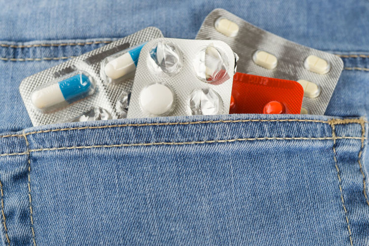 Close-up of jeans with blister packs