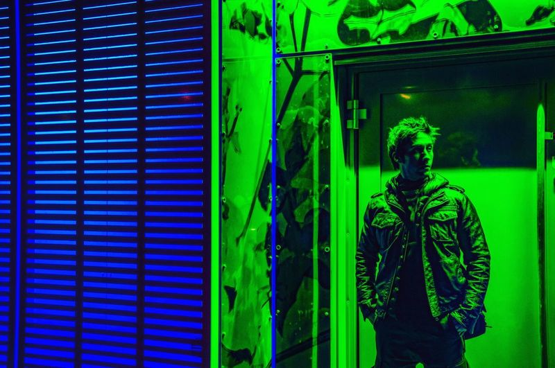 The real Santa was wearing green Neon Lights Colours Green Color Green Blue Twins Stifanibrothers FilmmakersLIFE Portrait Neon Green Color One Person Architecture Built Structure Indoors  Pattern Human Representation Window Standing Illuminated Glass - Material Day Real People Lighting Equipment