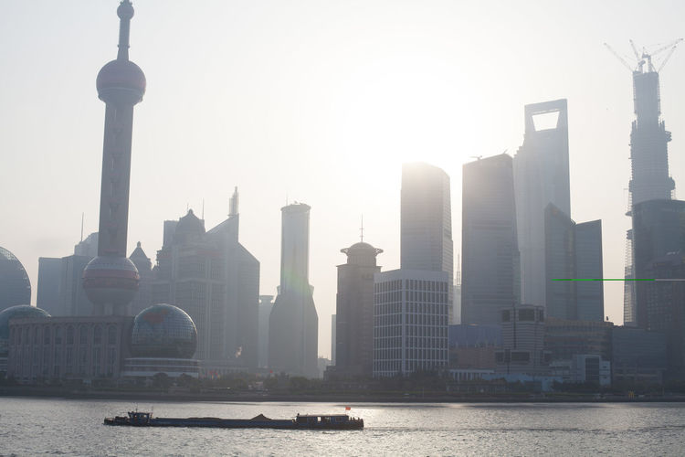 Oriental Pearl Tower And Shanghai World Financial Center By River On Sunny Day