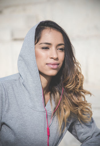 Portrait of beautiful young woman wearing hoodie