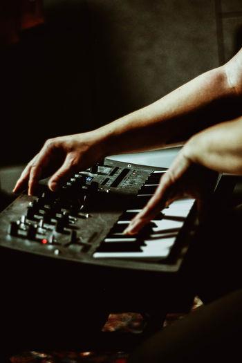 Cropped man playing keyboard instrument