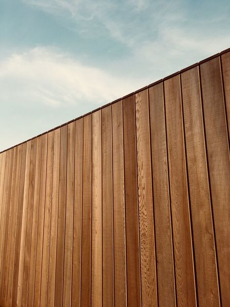 Sky Architecture Built Structure Low Angle View Cloud - Sky No People Day Nature Building Exterior Wall - Building Feature Pattern Wall Outdoors Building Fence Boundary Brown Barrier Metal Security