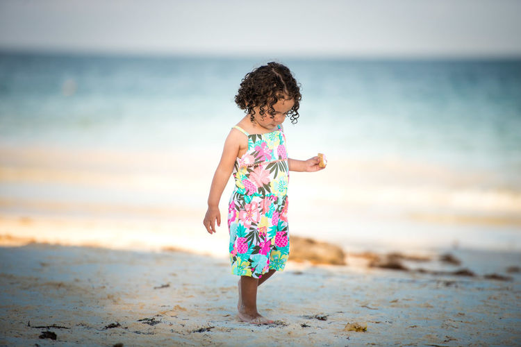 Beach Land Childhood Water Child Full Length Girls Real People Horizon Over Water People Nature Innocence Outdoors Lifestyles Freedom Alive  Walking