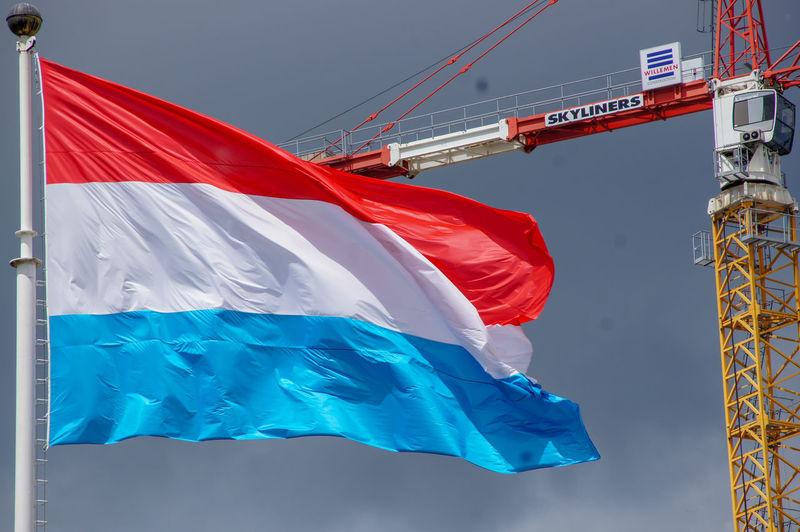 Luxembourg Flag Against a Moody Sky Flag Wind Low Angle View Sky Day Waving Striped Outdoors Luxembourg Luxembourg Flag