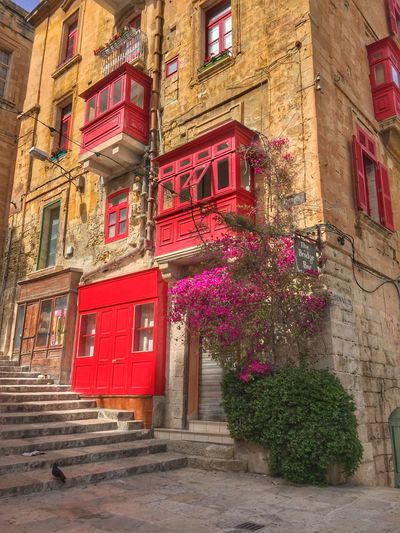 Traditional red wooden balconies on facade in Valetta, Malta Architecture Bougainvillea Building Exterior Built Structure Day Façade Facade Building Façade Medieval Architecture No People Outdoors Red Red Red Balconies Travel Destinations Wooden Balcony