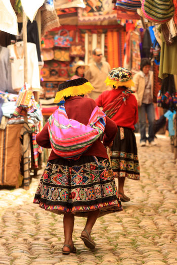 Traditional peruvian female dress at the markets in Pisac, Peru Love Life, Love Photography Color Cultures Day Focus On Foreground Outdoors People Real People Rear View Traditional Clothing Women Peru Peruvian Dress Females Pisac Perú Markets Street Walking Old Old-fashioned