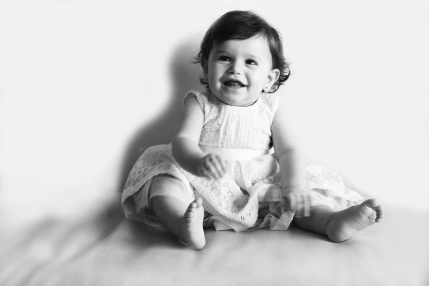 Baby Looking At Camera Portrait Full Length Smiling Innocence Cute Sitting Innocence Baby The Portraitist - 2017 EyeEm Awards Happiness Cheerful Babies Only Childhood Happiness One Person Babyhood Indoors  Sitting White Background Studio Shot People Day Adult The Portraitist - 2017 EyeEm Awards Black And White Friday