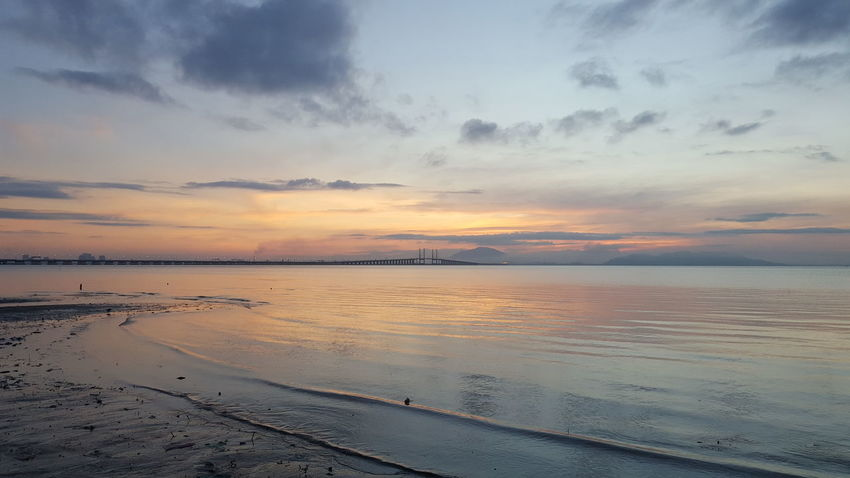 Penang Bridge Penang First Bridge Sunset Beach Water Reflection Sea Sky Beauty In Nature Scenics Tranquility Nature Dramatic Sky Tranquil Scene Horizon Over Water Outdoors Landscape Idyllic Cloud - Sky Blue Low Tide Summer