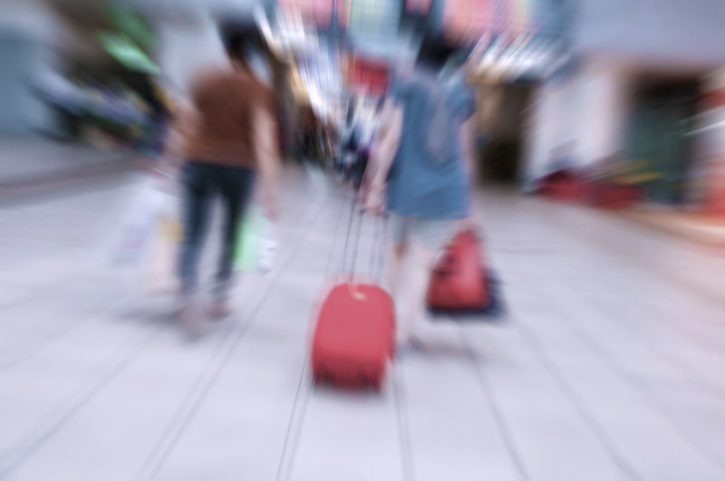 Blurred Motion Group Of People Real People Walking Motion Lifestyles Women Adult People Transportation Low Section Selective Focus Unrecognizable Person Day Human Body Part Men Human Leg Incidental People Indoors  Casual Clothing
