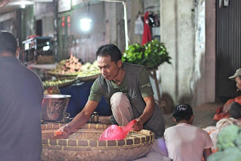 Man Selling Carrot At Market
