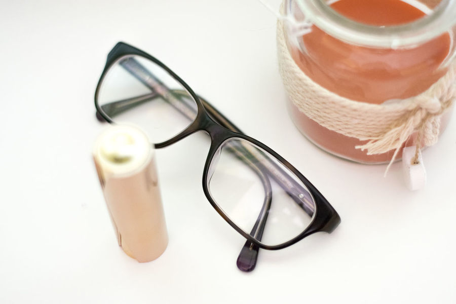 Beauty Beauty In Ordinary Things Lipstick Lipgloss Beauty Care Routine Lifestyles Autumn Eyesight Eyeglasses  Eye Test Equipment Eyewear Optometrist Healthcare And Medicine Table High Angle View Still Life Close-up Vision Glasses Iris Head And Shoulders Eyelash