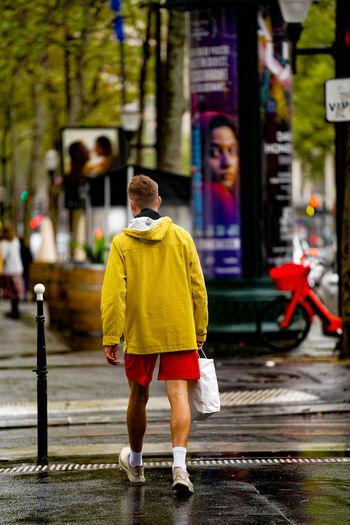Full length rear view of man walking on street