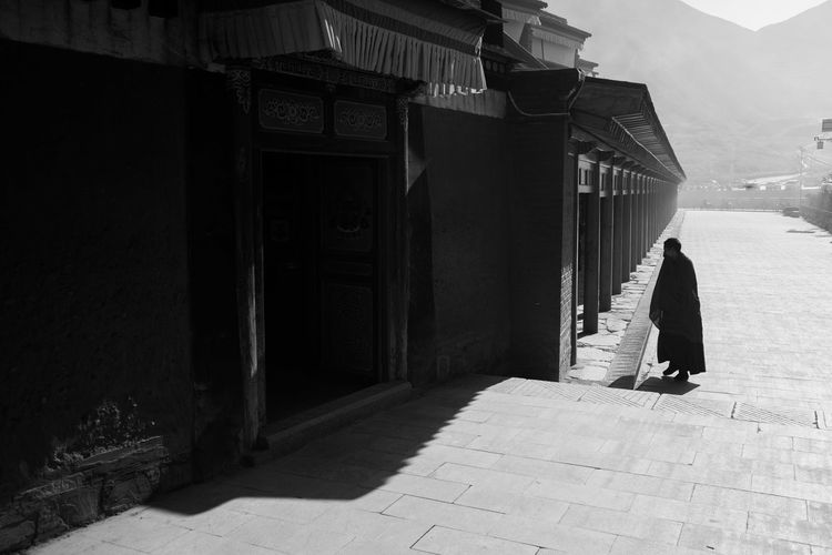 Side view of woman standing on street