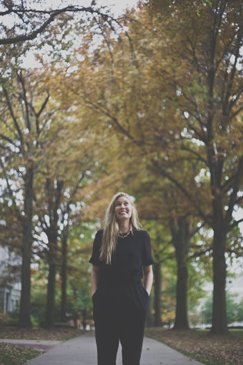 Young college student on campus Autumn Blonde Casual Clothing College College Campus Fall Focus On Foreground Leisure Activity Lifestyles Long Hair Park - Man Made Space Person Young Adult Young Women
