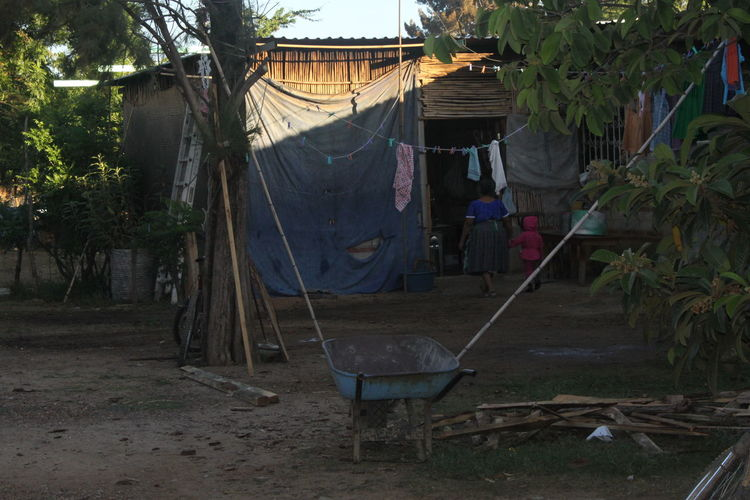 Clothes drying on swing against house
