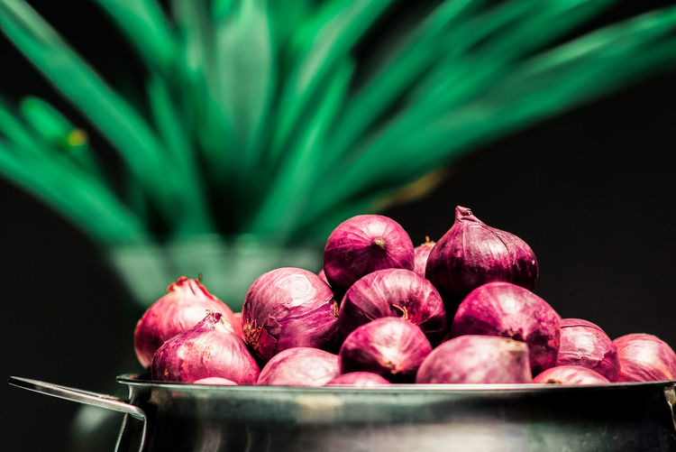 Close-up of onions in container