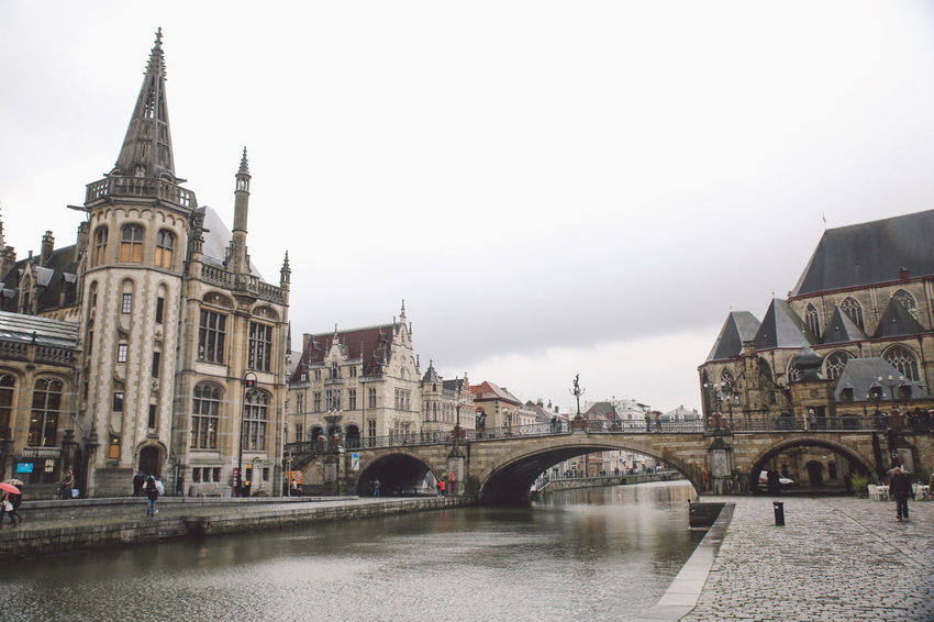Arch Architecture Belgium Bridge - Man Made Structure Building Exterior Built Structure City City Connection Day Ghent History Nature No People Outdoors River Sky Tourism Travel Destinations Water Winter