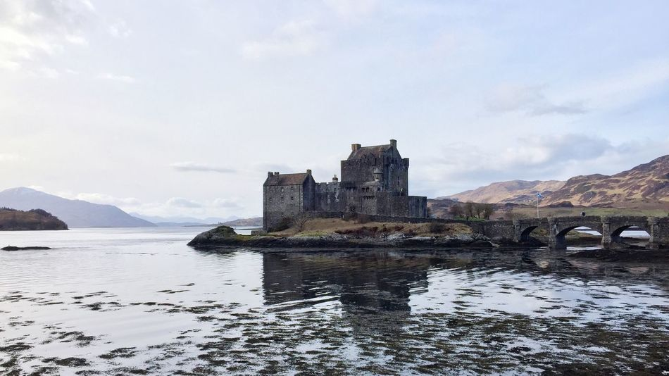 Architecture Built Structure Sky Water Reflection Day Building Exterior Outdoor Photography Eyeemphotography EyeEmNewHere EyeEm Nature Lover Ancient EyeEm Best Shots Waterfront Cloud - Sky Mountain Nature No People Castle Beauty In Nature Fortress Scotland Outdoors Lake Ancient Civilization Eilean Donan castle de camino a Skye. The Great Outdoors - 2017 EyeEm Awards Neighborhood Map Your Ticket To Europe Lost In The Landscape