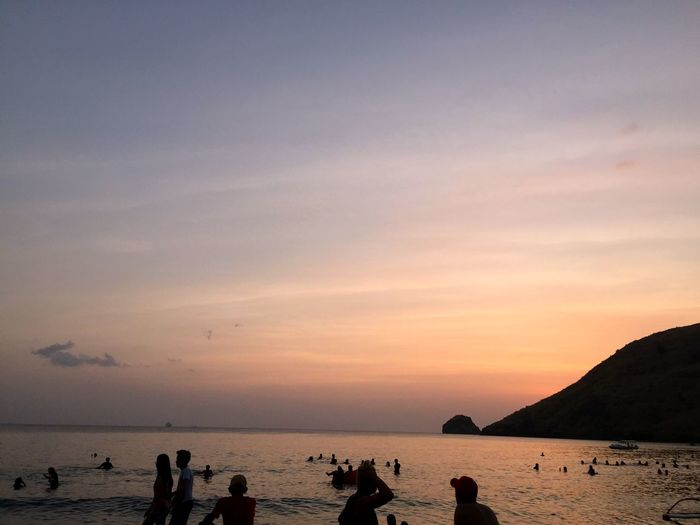 Painter's Summer Sky Philippines Zambales Anawangin Sunset Sky Water Group Of People Sea Beauty In Nature Beach Cloud - Sky Real People Silhouette Horizon Orange Color Large Group Of People Horizon Over Water Land Scenics - Nature Leisure Activity Nature Lifestyles