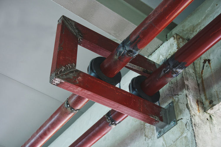 High angle view of red metallic structure on wall