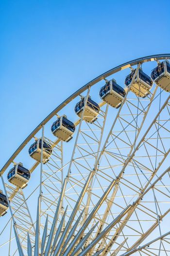 Amusement Park Blue Low Angle View Leisure Activity Rollercoaster Arts Culture And Entertainment Amusement Park Ride Day Clear Sky Sky Outdoors No People Close-up Sunlight Sunshine Poland Gdansk Ferris Wheel Europe Morning Big Wheel Sky And Clouds Panoramic Gdanks Low Angle View