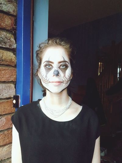 Portrait of young woman with halloween make-up