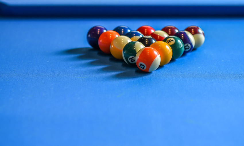 Close-Up Of Pool Balls Arranged On Table
