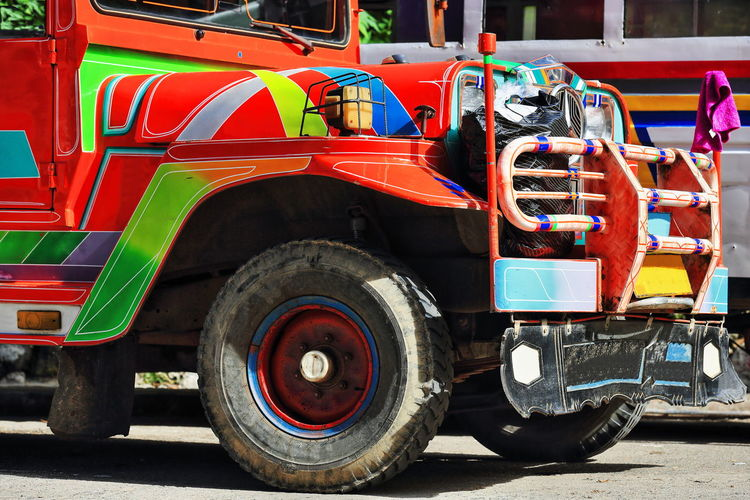 Multicolored truck park on road