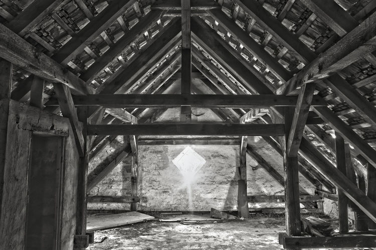 Alone in a sunny old attic // Abandoned Abandoned Places Ancient Architectural Column Architecture Attic Below Column Construction Deterioration Empty Engineering From My Point Of View HDR Idyllic Interior Lost Places No People Old Roof Run-down Sunbeam Sunlight SUPPORT Wood - Material