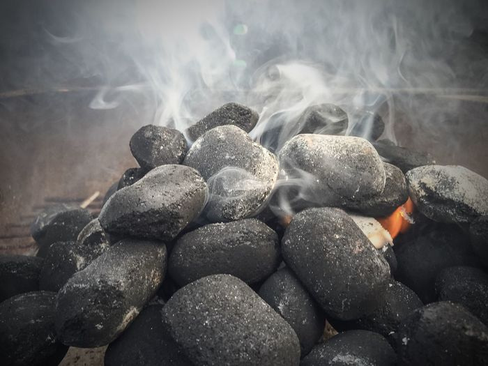 Close-Up Of Smoke Emitting From Charcoals