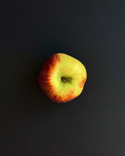 High angle view of apple against black background