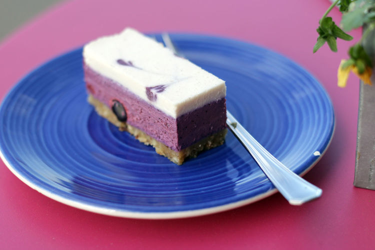 High Angle View Of Blueberry Cheesecake Dessert In Plate On Table