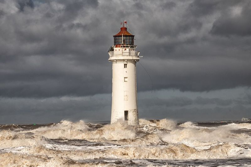 Perch rock lighthouse Liverpool Gale Stormy Weather Lighthouse Perch Rock Shoreline Waves Crashing Stormy Sea Waves Rolling In Steve Samosa New Brighton Waves Coastline Tower Lighthouse Guidance Sky Cloud - Sky Safety Built Structure Outdoors Water Nature Beach
