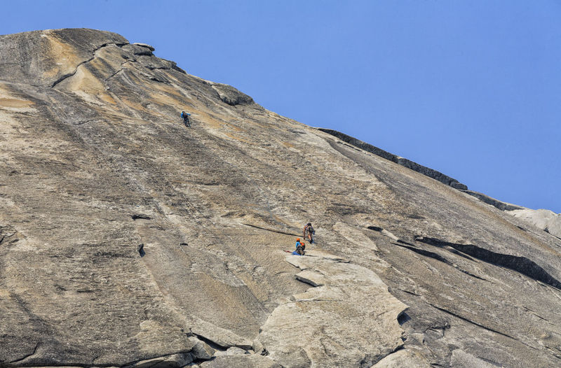 Low Angle View Of Rock Climbers At Yosemite National Park