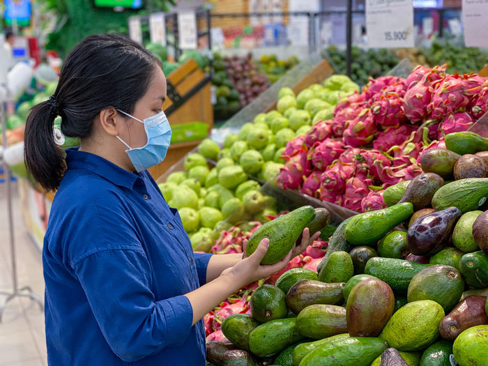Midsection of woman with fruits at market