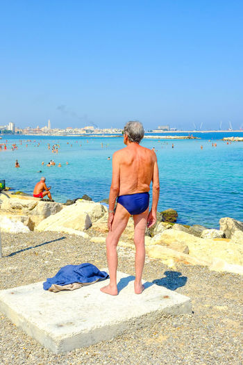 Beach Person Puglia Streetphotography Lonely Street Photo Street Photography Bari Sud Puglia, Italy Sea Andrea Gasso Colors Water Clear Sky Beach Rear View Sand Full Length Sea Vacations Leisure Activity Blue Copy Space Summer