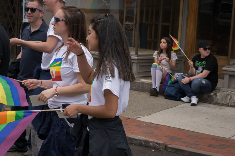 Two kids staying in the background during the Pride Parade in Buffalo, NY Celebration Event Rainbow Flags The Street Photographer - 2018 EyeEm Awards Architecture Boys Casual Clothing Child Females Girls Group Group Of People Interested Kids In The Background Leisure Activity Males  Men People Pride Parade Real People Teenager Teens Women Love Is Love
