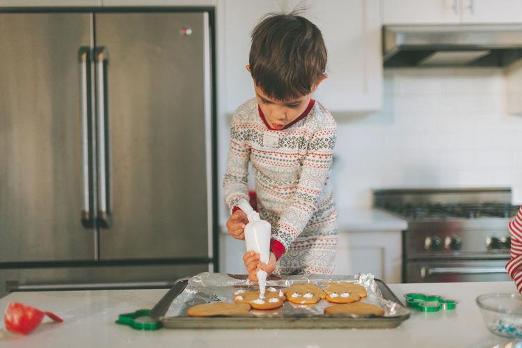 Boy preparing food at home