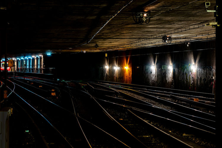 look into the darkness darkness and light S-bahn Artificial Light Long Exposure Black Empty Underground Blue Light Lamp Railroad Track Rail Transportation Track Illuminated Architecture Transportation Public Transportation Night Lighting Equipment Built Structure No People Mode Of Transportation The Way Forward Direction Tunnel Subway Outdoors Railroad Station City Light