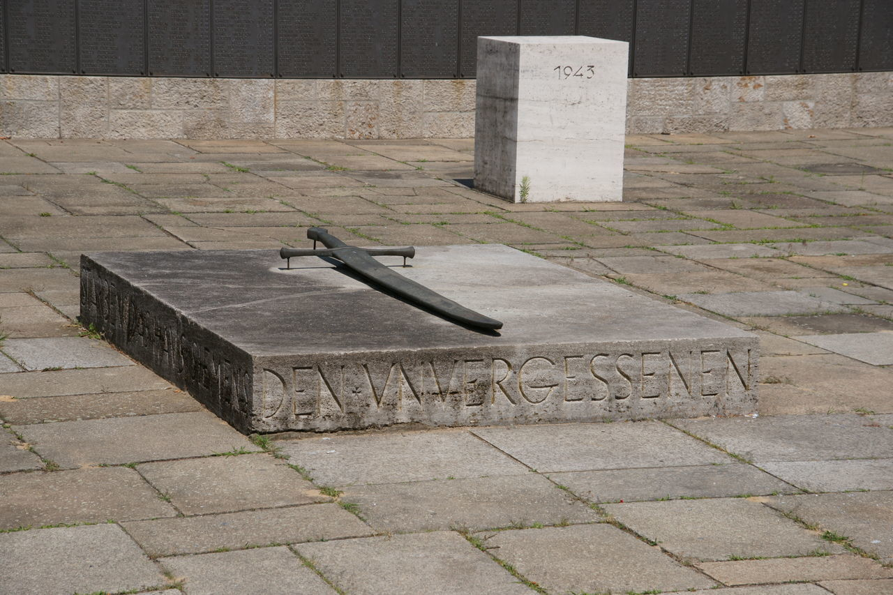 High Angle View Of Memorial Sword With Text