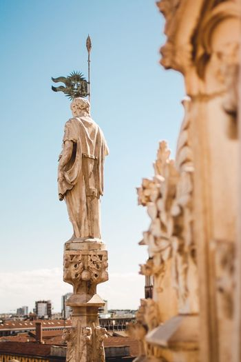 Statue Human Representation Art And Craft Sculpture Sky Outdoors Day Architecture No People Architectural Column Low Angle View Built Structure Clear Sky Building Exterior Travel Destinations Milan,Italy Milano Milan Statue Italy Holidays Italy Photos Italy Roof City Architecture