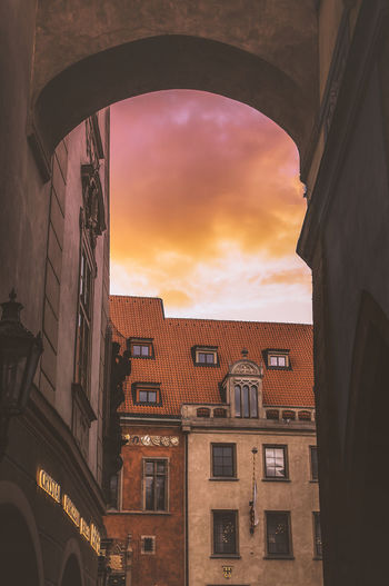 Architecture Built Structure Building Exterior Building Sky Cloud - Sky Window No People City Residential District Nature Sunset Low Angle View Orange Color Outdoors Arch Day Communication Dusk House Apartment