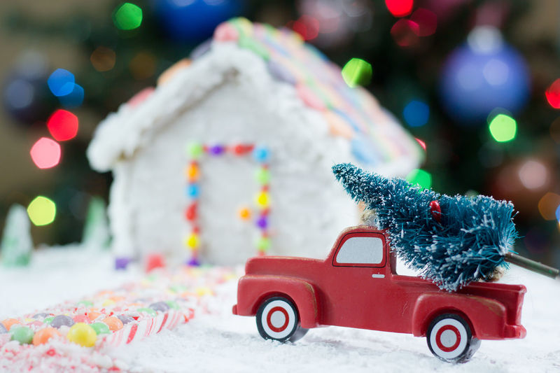 Close-up of toy car with gingerbread house at home during christmas