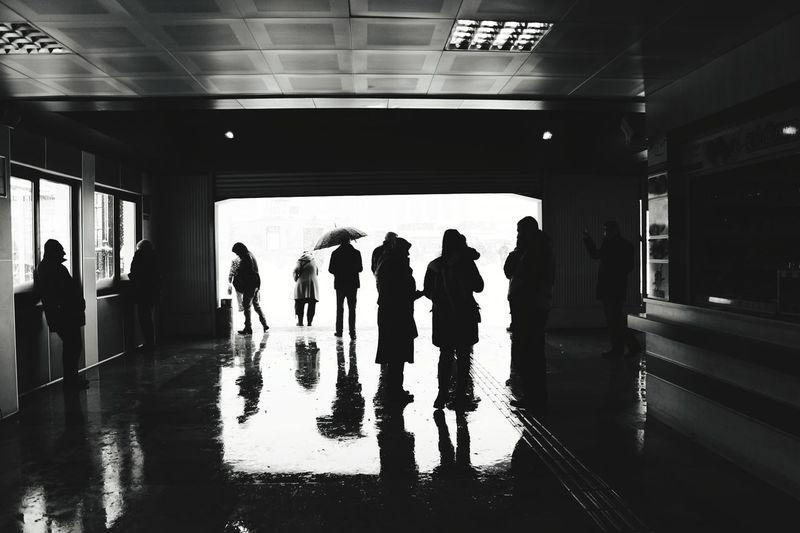 Group of people walking on railway station platform