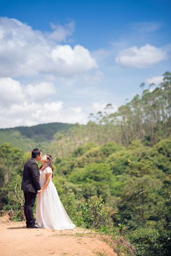 Adult Adults Only Bride Bridegroom Couple - Relationship Day Heterosexual Couple Husband Love Men Nature Newlywed Oath Outdoors People Romance Togetherness Traditional Clothing Two People Wedding Wedding Ceremony Wedding Dress Wife Women Young Adult