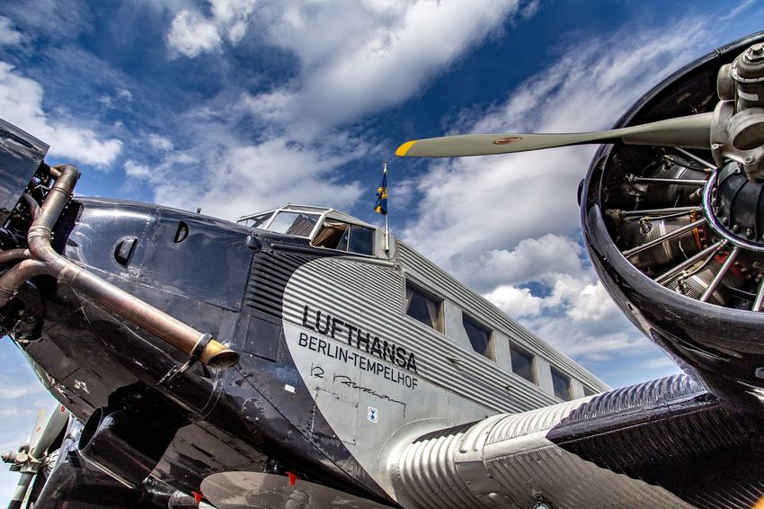 JU 52 Sky Cloud - Sky Mode Of Transportation Day Low Angle View Architecture Nature Built Structure Air Vehicle Transportation Building Exterior No People Airplane Travel Outdoors Metal City Travel Destinations Train Sunlight
