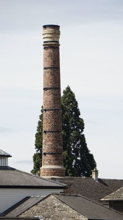 4163 Architectural Column Architectural Detail Architecture Architecture Architecture_collection Bricks Building Exterior Built Structure Chimney Day High Angle View Industry No People Outdoors Roof Roof Tile Rooftop Sky Sky_collection Smoke Stack Tree Tree Tree_collection  Trees And Sky