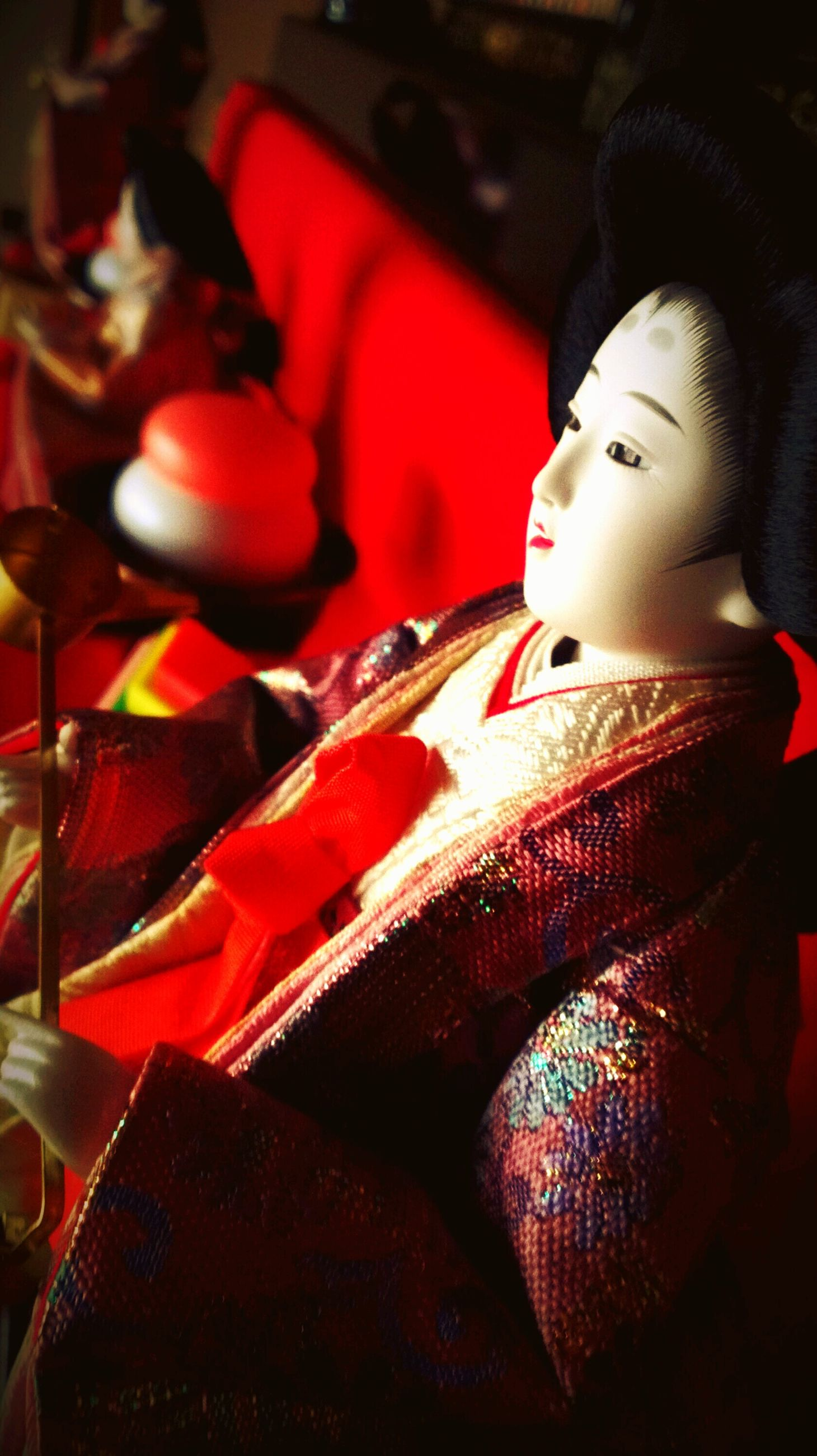 indoors, close-up, red, human representation, art and craft, focus on foreground, still life, arts culture and entertainment, tradition, retail, art, music, selective focus, large group of objects, religion, spirituality, no people, cultures