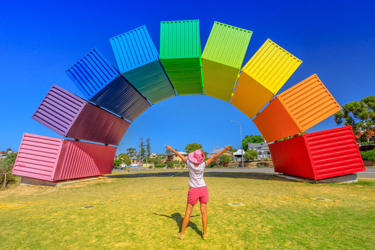Happy woman with open arms looking Rainbow Sea Container in Fremantle, Western Australia. Female tourist enjoys at Fremantle welcome. Homosexuality and hope concept Freemantle Perth Perth Australia Western Australia Australia Australian Rainbow Bridge Colorful Rainbow Colors Rainbow🌈 Blue Sky Woman Homosexual Love Pink Color Girl Females Happy Happyness Land One Person Sky Real People Multi Colored Leisure Activity Human Arm Clear Sky Lifestyles Casual Clothing Childhood Nature Standing Grass Women Day Blue Architecture Front View Limb Arms Raised Outdoors Excitement